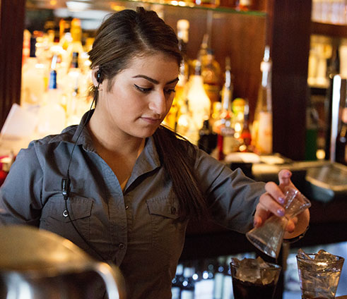 Bartender with earpiece radio